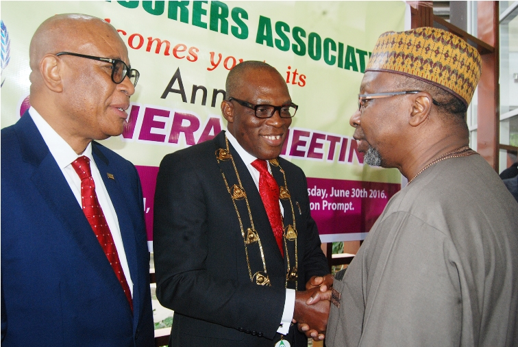 R-l: Commissioner for Insurance, Mr Mohammed Kari, congratulates the Managing Director, Consolidated Hallmark Insurance Plc, Mr Eddie Efekoha, after his investiture as the new Chairman, Nigerian Insurance Association (NIA), during the 45th Annual General Meeting of NIA in Lagos on Thursday. With them is the immediate past chairman, NIA, Mr. Godwin Wiggle.