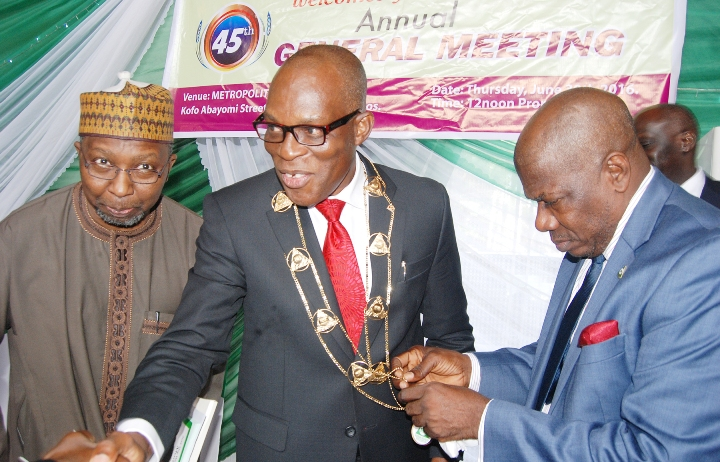 L-R: Commissioner for Insurance, Mr Mohammed Kari; Managing Director, Consolidated Hallmark Insurance Plc, Mr Eddie Efekoha, and Director General, Nigerian Insurance Association (NIA), Mr. Sunday Thomas, at the investiture of Mr. Efekoha as the new NIA Chairman during the 45th Annual General Meeting of NIA held in Lagos on Thursday 30:6:2016 (yesterday).
