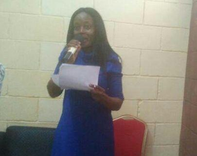 The author, Julie Omeike, at a reading session in Lagos.